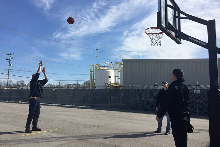 ZEON employees shooting basketball at lunch